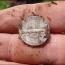 Metal detecting hunt turns up old silvers and tokens