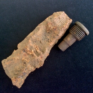 Reverse of fragment showing artillery fuse threads, pictured with a matching fuse I found last week.