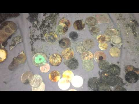 Metal Detecting For Treasure On The Beach