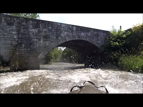 Racing Downriver In A Motorized Kayak