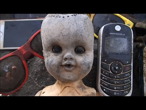 River Treasure: Creepy Doll, 2 iPhones (5 phones), Military Dog Tag and MOAR!